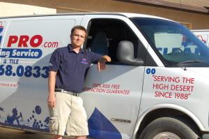 Josh standing by van